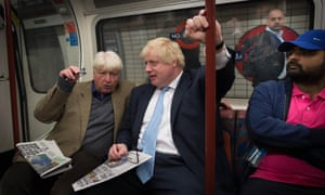 Boris Johnson sits next to his father Stanley (left) on the tube