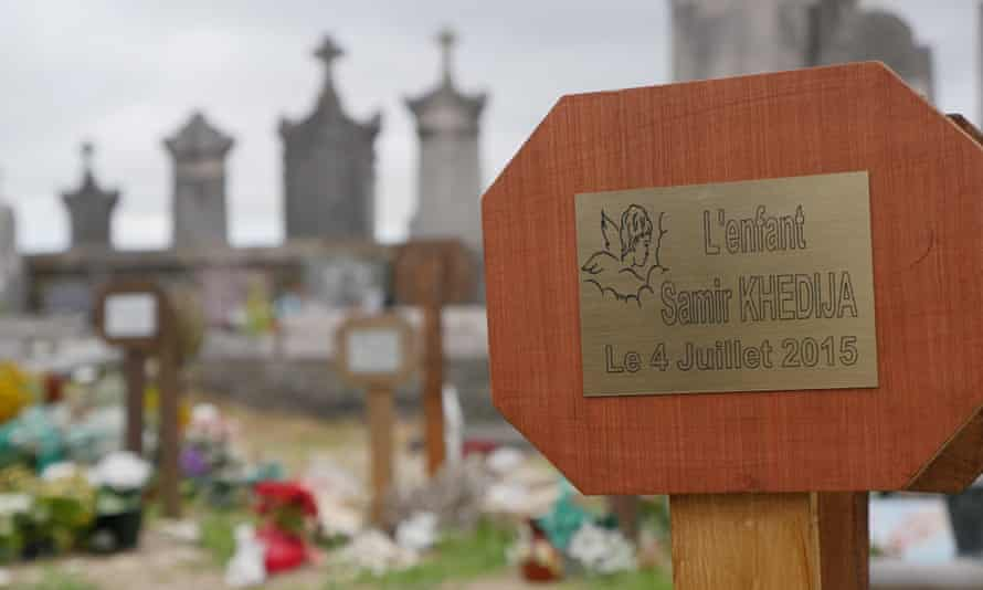 Freshly laid grave of Samir Khedija, a baby who was stillborn in Calais after her migrant mother fell off a lorry trying to get in to the UK. Photo by John Domokos for the Guardian
