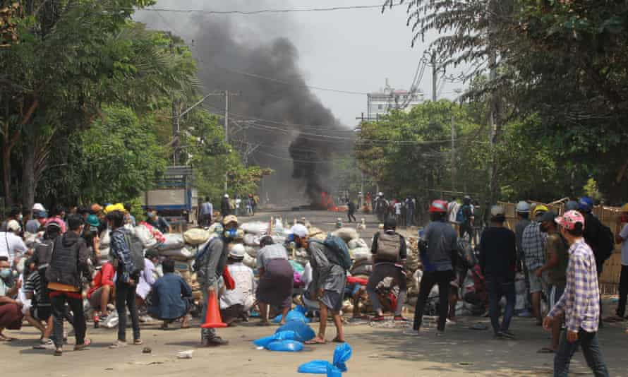 Anti-coup protesters block a street