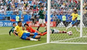 Brazil's Neymar scores their first goal