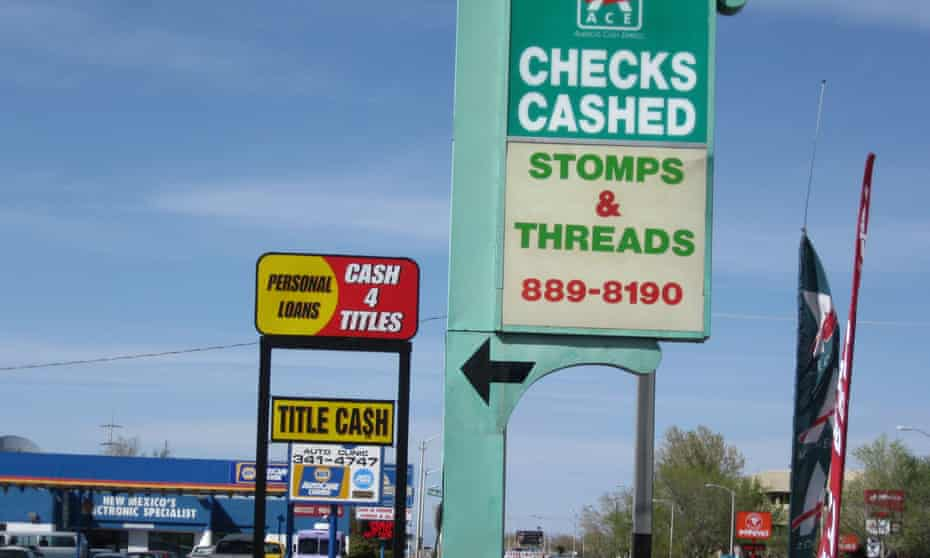 An Ace Cash Express outlet is seen on San Mateo Boulevard in Albuquerque, New Mexico. The outlet sits on a block which has three small loan storefronts.