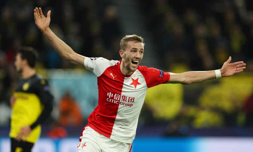 Slavia Prague midfielder Tomas Soucek celebrates his goal against Borussia Dortmund with outstretched arms