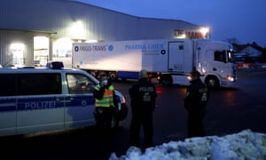 German police escort a lorry carrying the Pfizer-BioNTech vaccine.