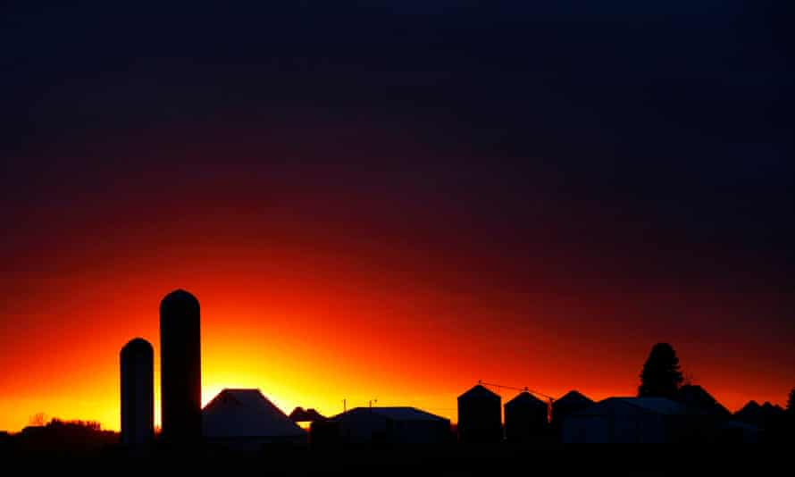 Light on the horizon ... the sun sets over a silhouette of a farm in rural Iowa, where Robinson's novel is set.