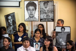 Relatives of the victims of Fujimori's regime and their lawyers attend a press conference on 27 December.
