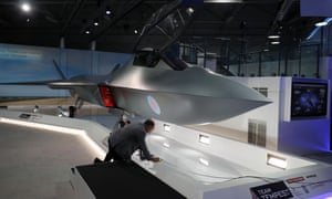 A model of the new Tempest fighter jet is prepared for unveiling at the 2018 Farnborough airshow.