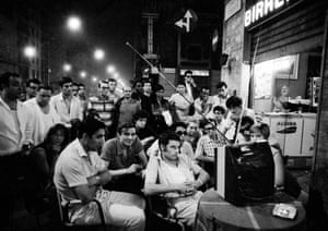 Italians follow the moon landing outside a cafe in Milan.