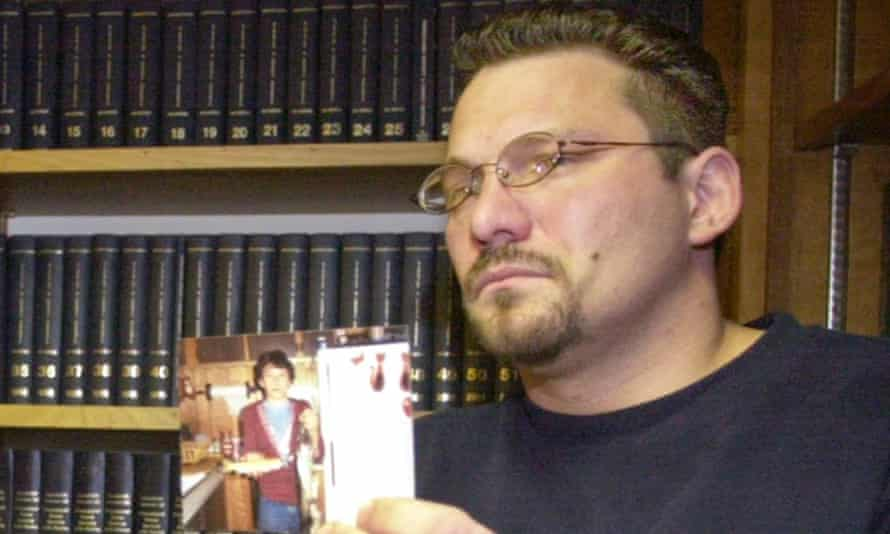 Brian Gergely shows an old photograph of himself during a news conference in 2003.