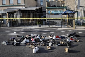 Pairs of shoes belonging to victims piled behind the Ned Peppers bar.