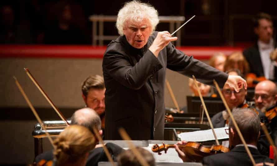 Simon Rattle conducts the London Symphony Orchestra at Symphony Hall, Birmingham.