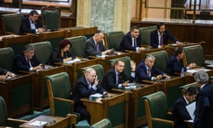 Politicians vote during a Senate meeting at the Romanian Parliament, in Bucharest.