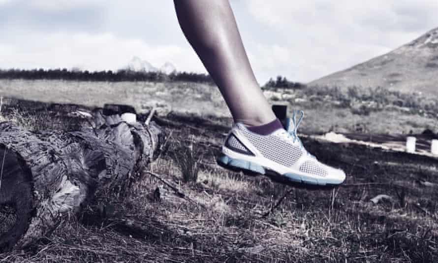 Woman running in wild