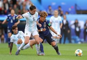 Aldana Cometti of Argentina battles for possession with Yuki Sugasawa of Japan.