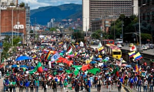 Indigenous people and students take part in a protest against the government of the Colombian president, Iván Duque, in Bogota, on 4 December 2019.
