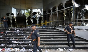 Police officers guard the Congress entrance in Asuncion, Paraguay.