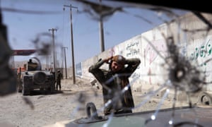An Afghan soldier keeps watch at a checkpoint on the Ghazni-Kabul highway in Afghanistan.