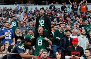 Jets fans cheer on their team during the third quarter.