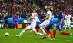 Kolbeinn Sigthorsson pulls a goal back for Iceland against France.