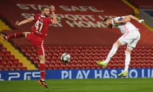 Karim Benzema of Real Madrid wins a header whilst under pressure from Nathaniel Phillips of Liverpool.