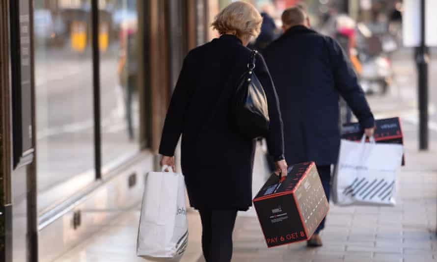 a woman with shopping bags