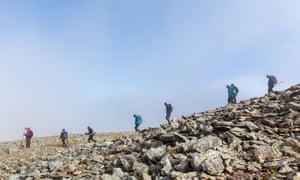 Hill walkers on Moel Siabod mountain.