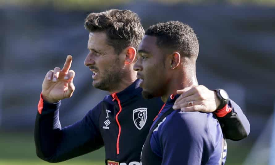 Bournemouth assistant manager Jason Tindall gives Jordon Ibe instructions during training.
