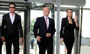 Flanked by Brad Pitt and Angelina Jolie, William Hague arrives at the global summit to end sexual violence in conflict in 2014