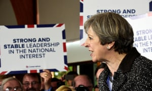 Theresa May speaks to supporters at the Brackla community centre in Bridgend, south Wales.