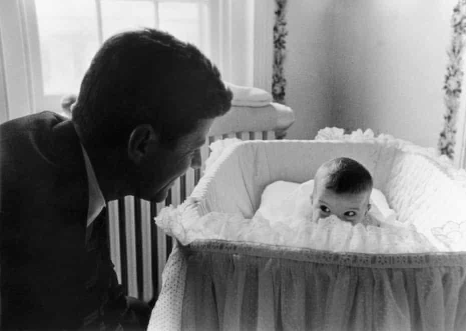 Senator Kennedy and baby Caroline, Washington DC, 1958, by Ed Clark.