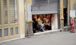 People take shelter inside a shop