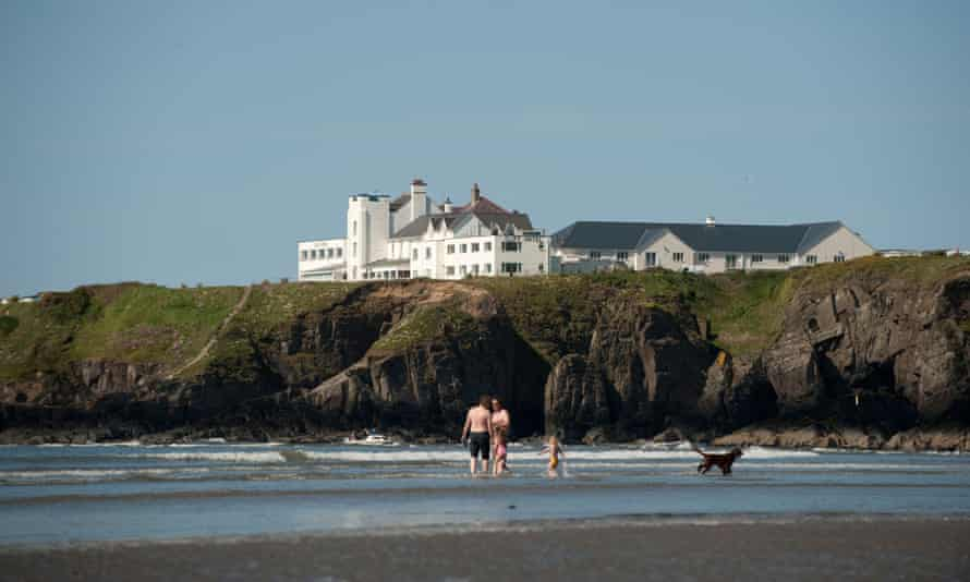 Shore leave: The Cliff Hotel, seen from Poppit Sands beach, Pembrokeshire.