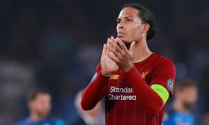 Liverpool's Virgil van Dijk applauds fans after the match.