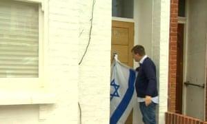 Man tying Israeli flag to Ken Livingstone's front door