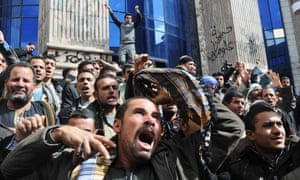 Egyptians in Cairo protest against perceived government inaction over the kidnapping of Coptic Christians in Libya.