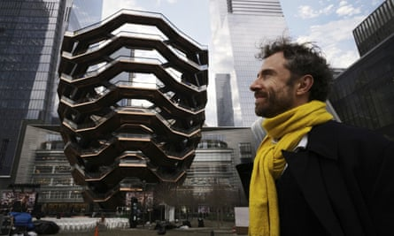 Thomas Heatherwick posing next to Vessel at Hudson Yards.