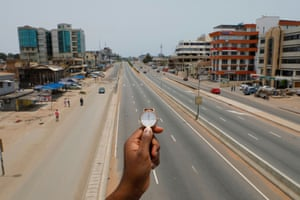 People walk past Ring Road Central Street in Accra, Ghana