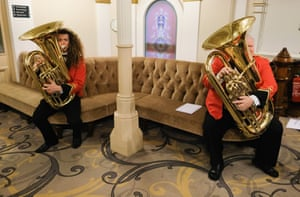 Musicians from the Strata brass band wait to be called forward to perform at Huddersfield Town Hall