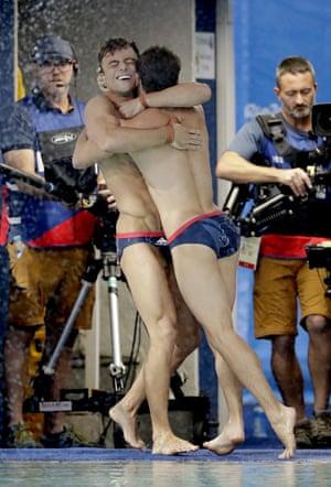 Britain's Tom Daley, left, and Daniel Goodfellow celebrate winning bronze.