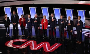 Democratic Presidential Candidates Debate In Detroit Over Two Nights<br>DETROIT, MICHIGAN - JULY 30: Democratic presidential candidates Marianne Williamson, (L-R), Rep. Tim Ryan (D-OH), Sen. Amy Klobuchar (D-MN), Indiana Mayor Pete Buttigieg, Sen. Bernie Sanders (I-VT), Sen. Elizabeth Warren (D-MA), former Texas congressman Beto O'Rourke, former Colorado governor John Hickenlooper, former Maryland congressman John Delaney, and Montana Gov. Steve Bullock take the stage at the beginning of the Democratic Presidential Debate at the Fox Theatre July 30, 2019 in Detroit, Michigan. 20 Democratic presidential candidates were split into two groups of 10 to take part in the debate sponsored by CNN held over two nights at Detroits Fox Theatre. (Photo by Justin Sullivan/Getty Images)