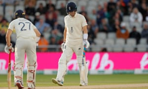 England's Joe Denly (right) walks off after being dismissed by Pat Cummins late in the day.