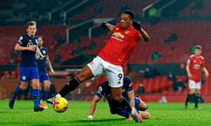 Manchester United's French striker Anthony Martial controls the ball in the build-up to scoring their fifth goal.