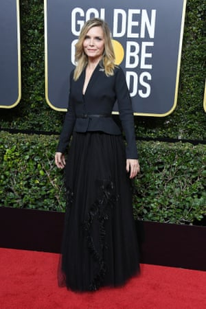 Michelle Pfeiffer, nominated for The Wizard of Lies, arrives on the red carpet.