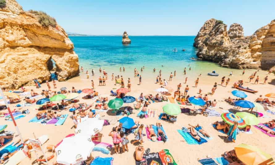 Bathers on Camilo Beach, Lagos, on the Algarve, Portugal.
