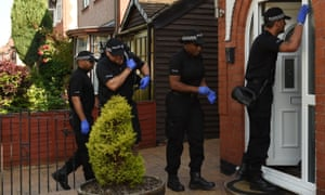 Police enter an address in Nuneaton after a man was arrested in connection with the Manchester Arena bombing.