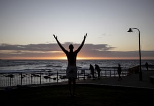 A yogi salutes the sun at Bronte beach