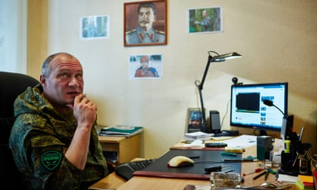 Ghost brigade commander Yuri Shevshenko in his office, with portraits of his heroes on the wall.
