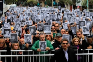Buenos Aires, Argentina Demonstrators hold pictures of victims of the 1994 bombing attack against the Argentine Israelite Mutual Association Jewish community centre that killed 85 people and injured 300, during the commemoration of the attack's 25th anniversary