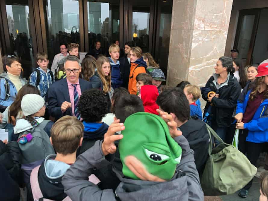 Australian Greens leader Richard Di Natale with students from the school walkout for climate action.