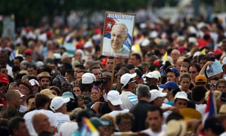 A man holds a placard bearing a picture of Pope Francis as the pope performs mass on Sunday.