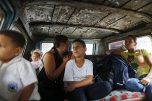 Passengers ride on public transport in Caracas.
